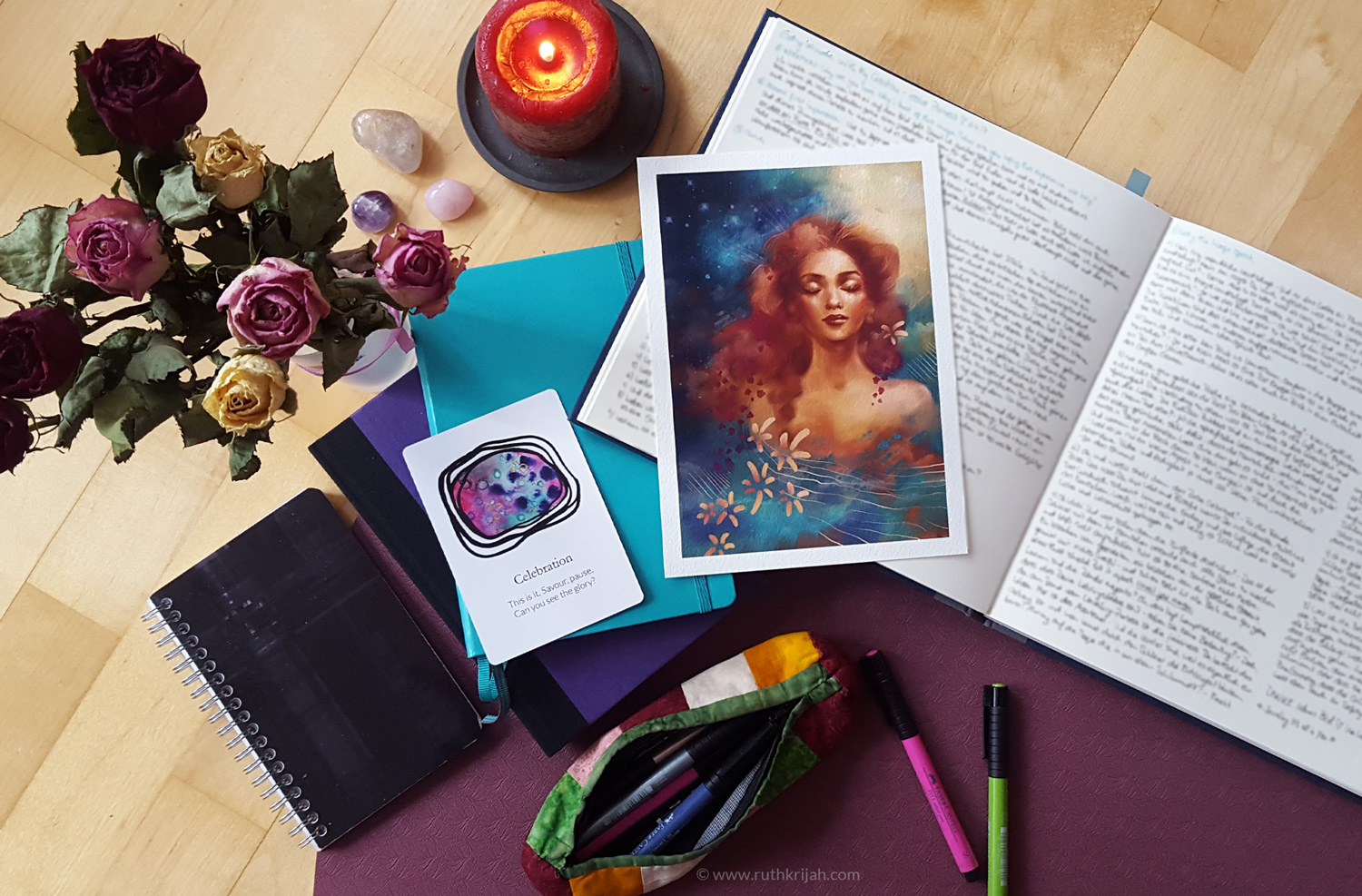 "Ruth Krijah Meditation Space with journals and an Inner Woman Art Print A5. Dried roses, rose quartz and ""celebration"" card from the future Youniverse Oracle Deck."